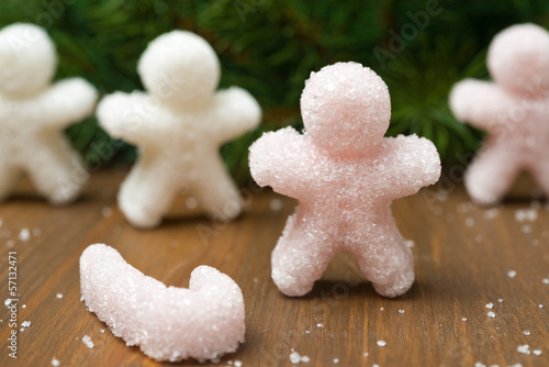 Multi-colored sugar in the form of little people