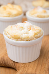 peach souffle in the portioned form, close-up, selective focus
