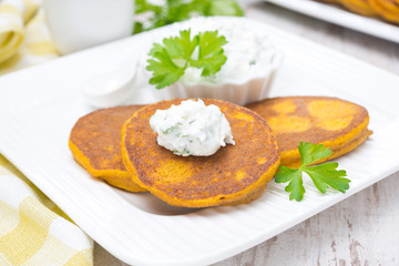 pumpkin pancakes with feta cheese sauce and greens