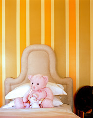 Pink teddy bear on child's bed