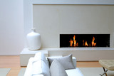 White living room with burning fireplace