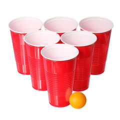 Beer pong. Red  cups and orange ping pong ball isolated