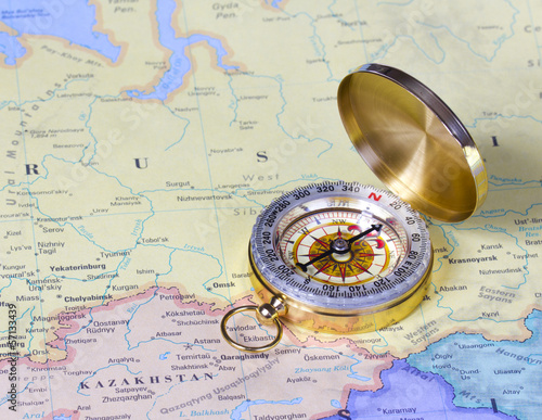 gold compass on map of Russia