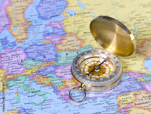 gold compass on map of Europe