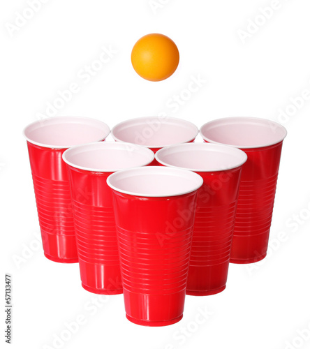 Beer pong. Red plastic cups and orange ping-pong ball isolated