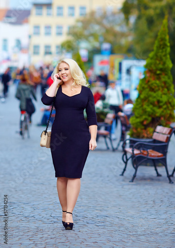 attractive overweight woman talking on the phone