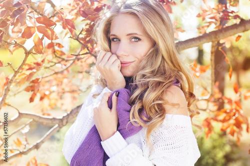 beautifull young girl near colourful tree