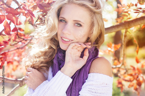 beautifull young girl near colourful tree