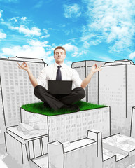 businessman sitting on skyscraper