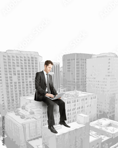 businessman sitting on building
