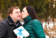 Happy young couple in love with present