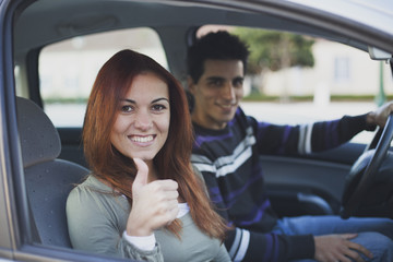 Young couple inside the car
