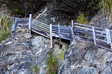 Wooden Stairs Going Up Cliff Wall Beach
