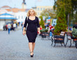 confident overweight woman walking the city street