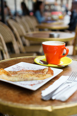 Coffee and pancake in a Parisian street cafe