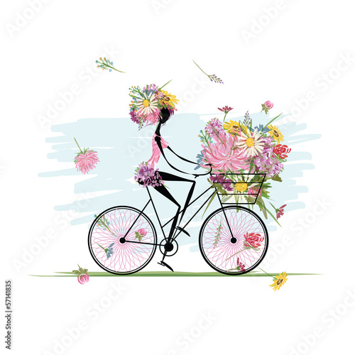 Girl with floral bouquet in basket cycling © Kudryashka