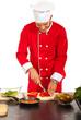 Chef male cut red bell pepper