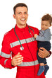 Cheerful paramedic holding baby