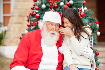 Santa Claus Listening To Girl's Wish