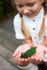 Little girl and snail