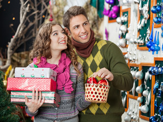 Couple With Presents Shopping In Store