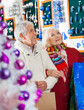 Senior Couple Shopping At Christmas Store