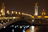 The Alexander III Bridge at night in Paris, France