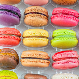 traditional french colorful macarons in a box poster