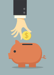business hand saving money in piggy bank