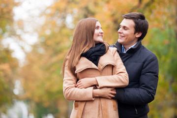 Teen couple in the autumn park