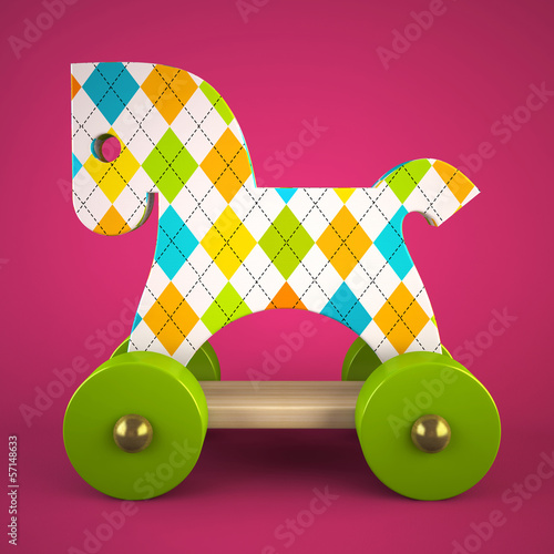 wood toy horse on purple background