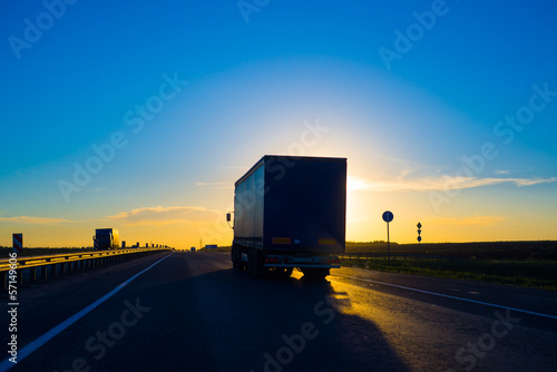Silhouette of a truck at sunset