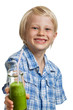 Cute boy with green smoothie or juice