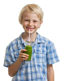 Cute boy drinking green smoothie