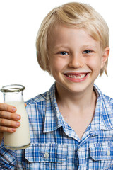 Cute boy with milk moustache and bottle
