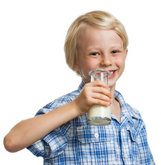 Smiling boy about to drink bottle of milk.