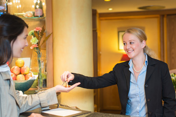 Smiling friendly hotel receptionist