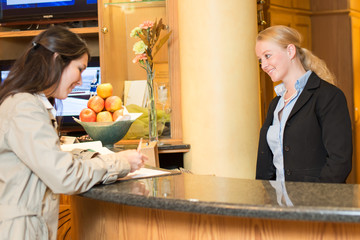 Young woman at the hotel reception