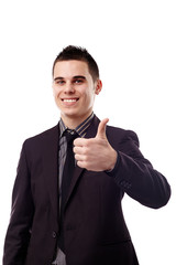 Young businessman making thumb up sign