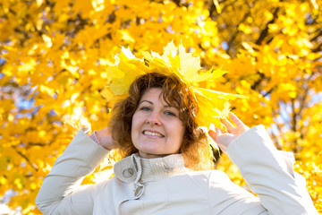 Middle-aged woman in the autumn park