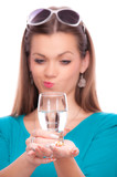 Young woman with half full glass of water