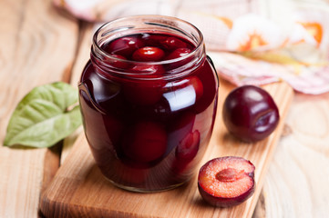 Homemade plum jam in glass jar.