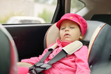 girl sleeping in car seat