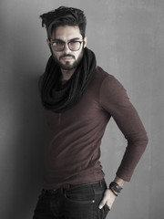 sexy man with beard dressed casual posing dramatic