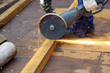 worker cuts metal profile