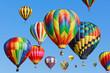 Leinwandbild Motiv colorful hot air balloons against blue sky