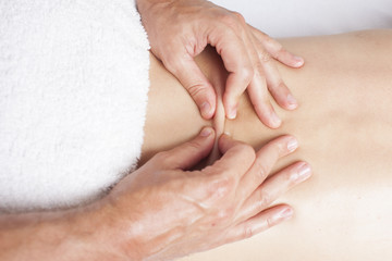 Chiropractor exercising female myofascial therapy