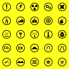 Warning sign icons on yellow background