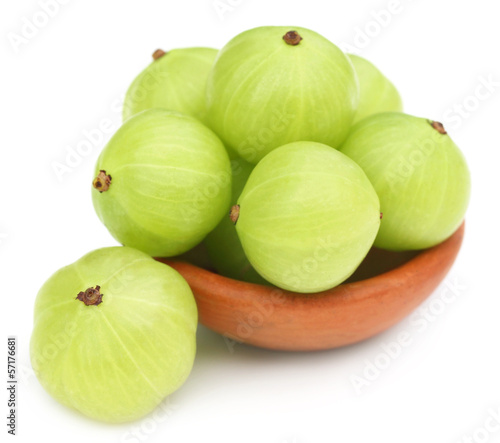 Fresh amla with a small brown bowl
