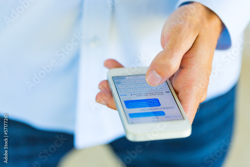 Man using smart phone, Texting